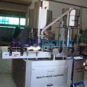 Automatic Four Head Ropp Cap Sealing Machine – 100R GMP Model